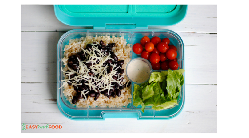 Black beans atop brown rice with cherry tomatoes and romaine on the side: a quick, healthy lunch