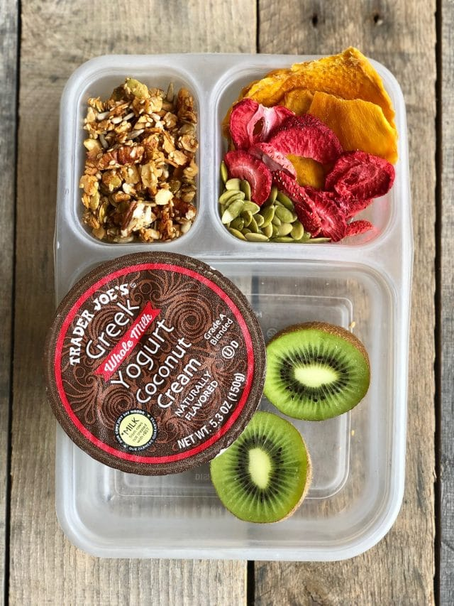 10 Simple School Lunches from Trader Joe's - yogurt, granola, a kiwi, dried mango, freeze dried strawberries and pumpkin seeds. #healthykids #healthykidslunch