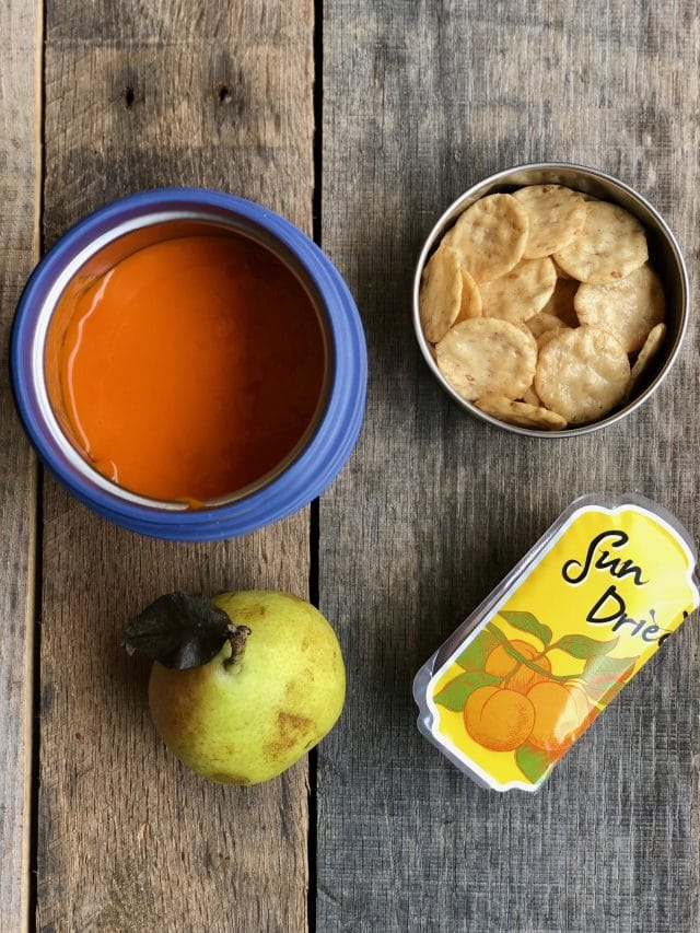 10 Simple School Lunches from Trader Joe's - tomato soup, gluten free crackers, dried apricots and a mini pear.