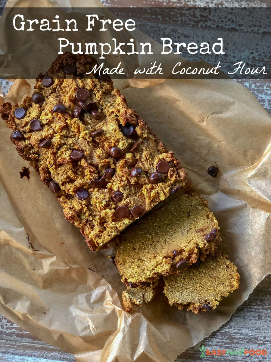 A loaf of grain free pumpkin bread made with coconut flour on parchment paper.  - #coconutflourrecipe