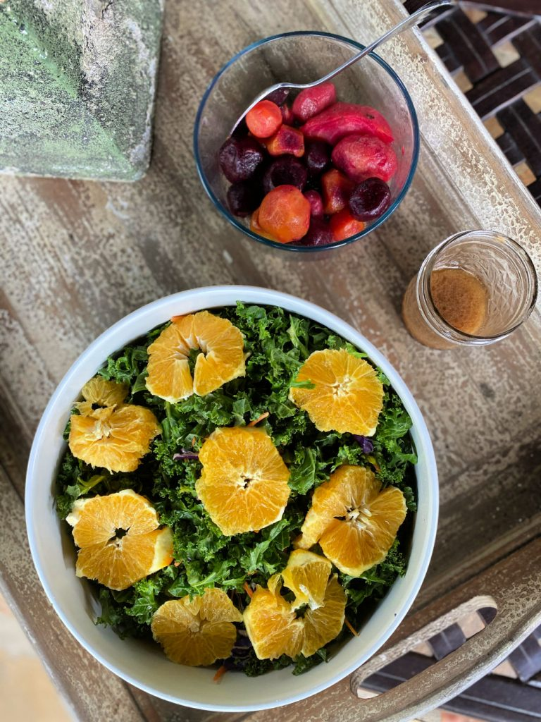 prepared kale salad with roasted baby beets on side