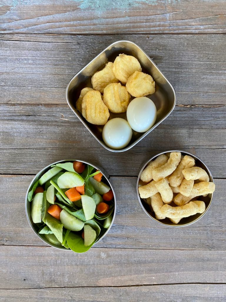 Chicken nuggets, hard boiled eggs, mixed green salad, Hippeas - another Costco lunch