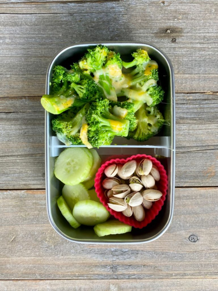 broccoli with cheese, cucumber and pistachios in a U Konserve lunch box