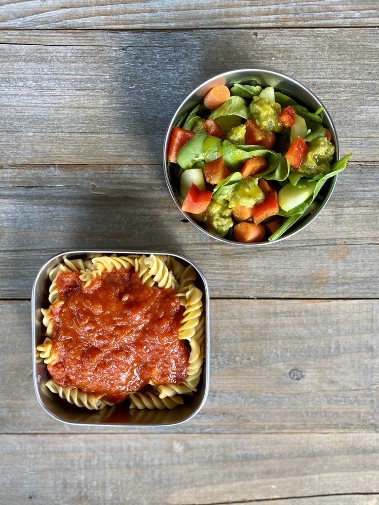 gluten free pasta with marinara, spinach salad with carrots, avocado, pepper, cucumber and honey mustard sauce