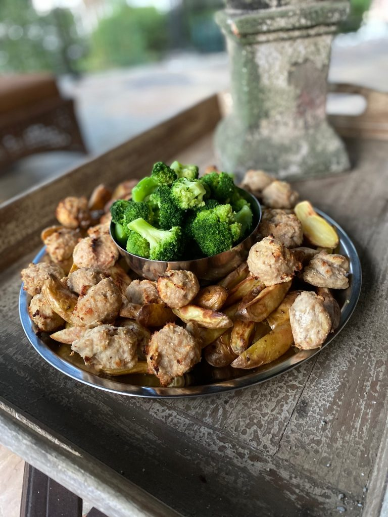 turkey meatballs on a platter with potatoes and broccoli