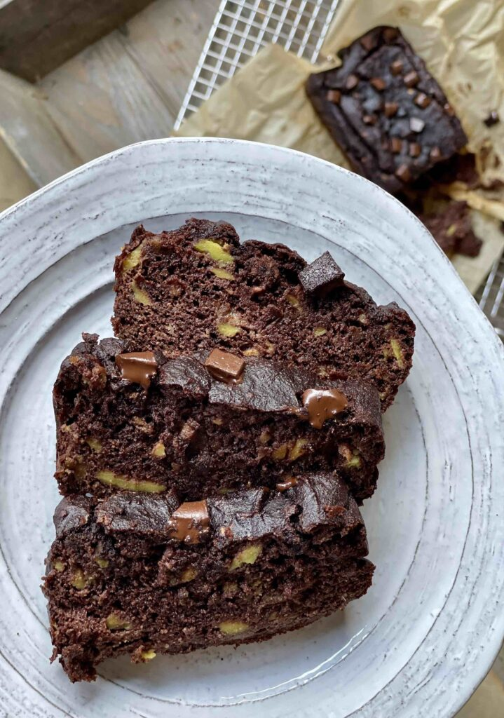 three pieces of chocolate avocado bread on a plate