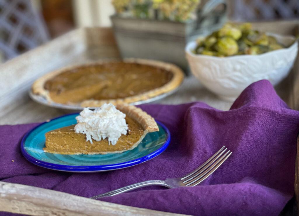 piece of gluten fee dairy free pumpkin pie with dairy free whipped cream